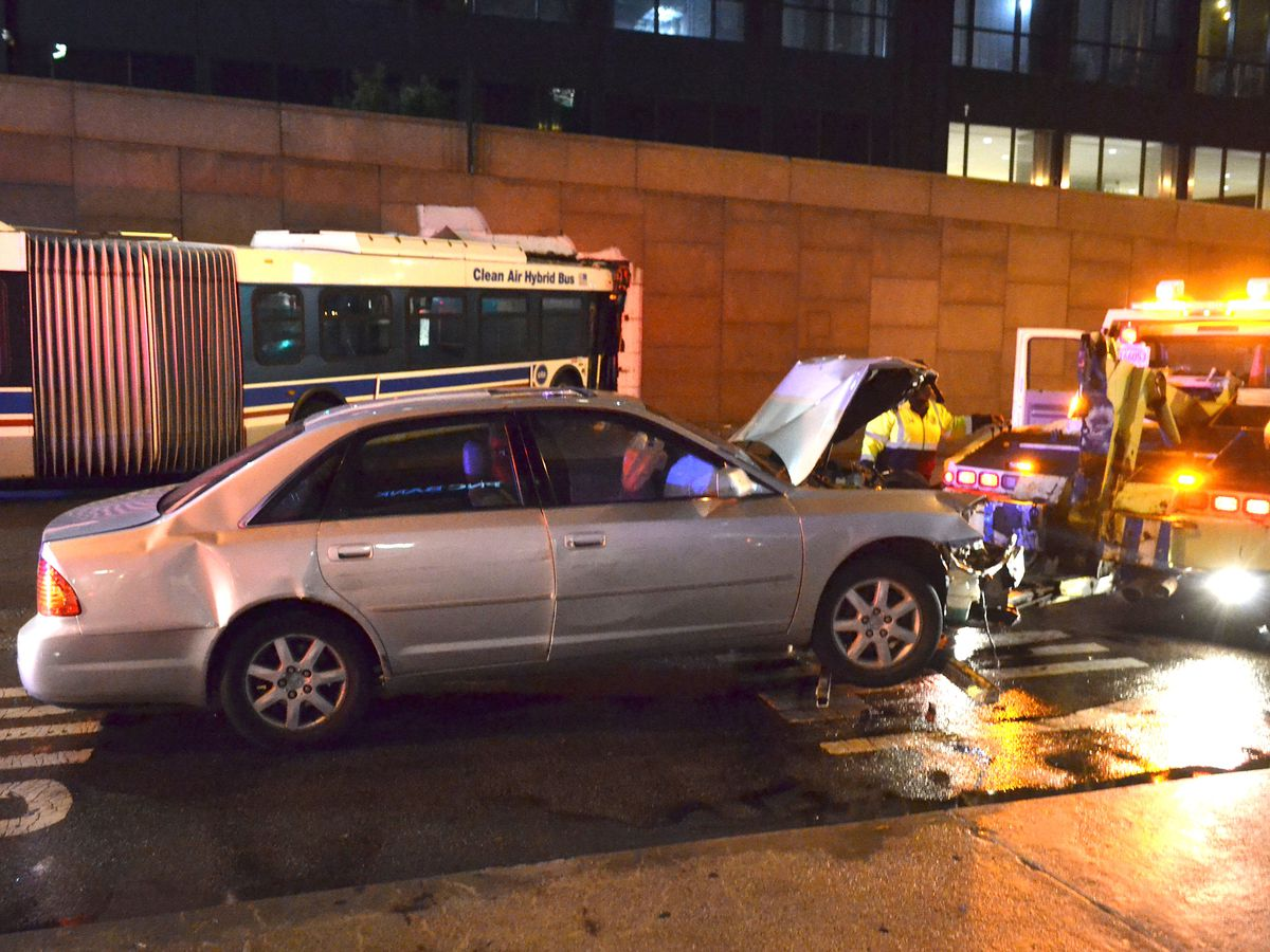 Police investigate a crash about 2:30 a.m. Saturday, October 6, 2018 in the 200 block of West Adams Avenue in Chicago. | Justin Jackson/ Sun-Times