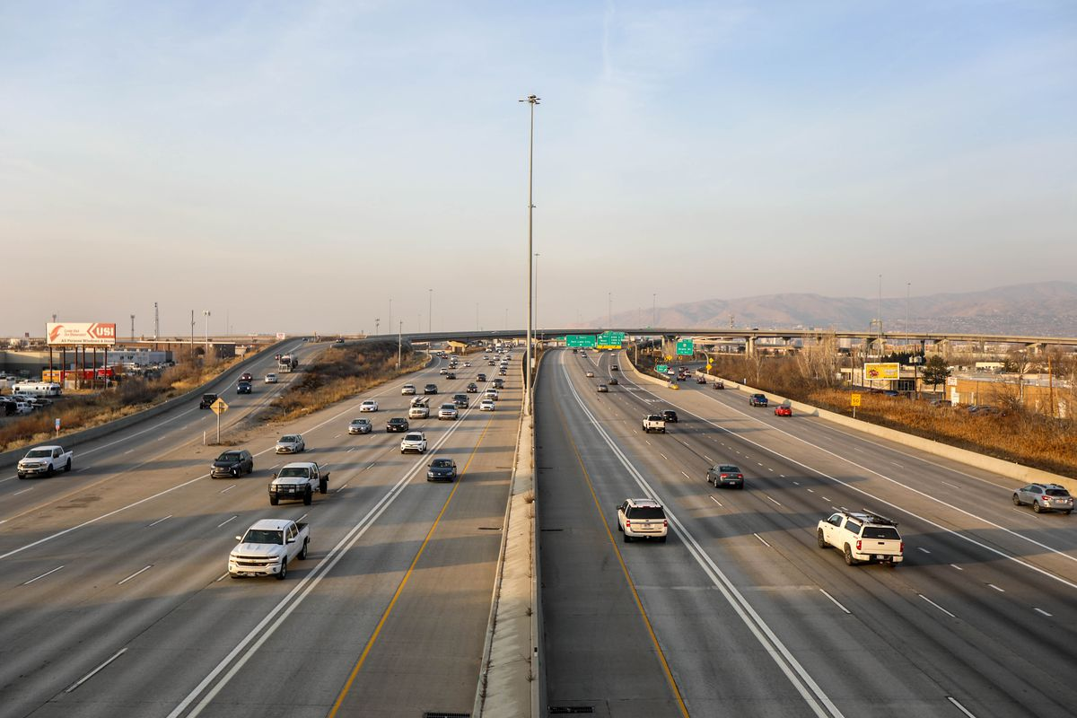 Cars travel north and south along I-15 in South Salt Lake on Monday, Jan. 11, 2021. More government workers will be out of their cars and in their home offices on days in Utah when air pollution is at unhealthy levels thanks to passage of a telecommuting bill that requires eligible state employees to stay put during certain times of the years.