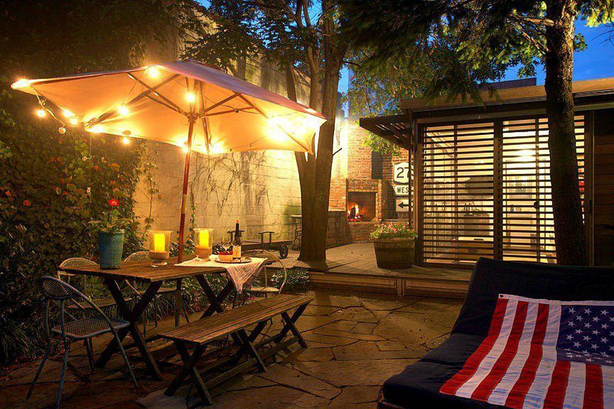 The backyard at night, accessorized with an American flag and all.
