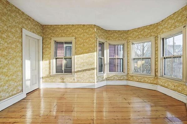 An empty bedroom with a bay window.