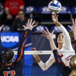Utah outside hitter Dani Drews hits the ball against a pair of Illinois State players during the first set of a first-round volleyball match in the 2019 NCAA Division I Women's Volleyball Tournament at the George Albert Smith Fieldhouse in Provo on Friday, Dec. 6, 2019.