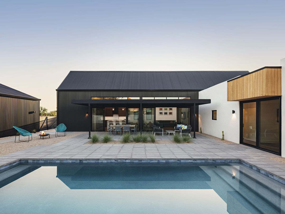 Pool surrounded by concrete patio.