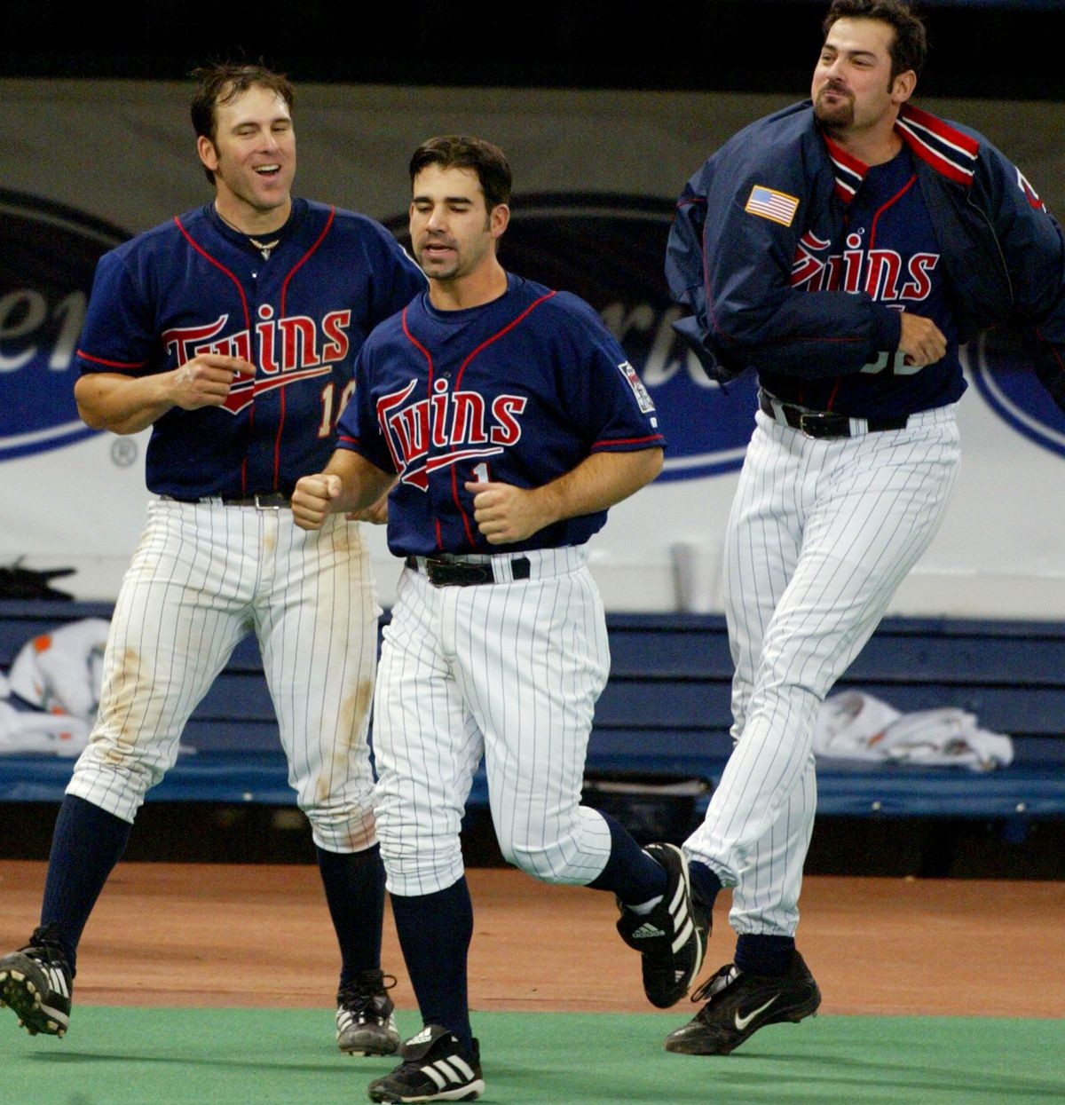 Minneapolis MN, 5/2/02 Twins vs. Devil Rays----Twins Doug Mientkiewicz 16 left, Jay Canizaro 1, and Tony Fiore celebrated Corey Koskie 10th inning home run against Tampa Bay giving a the Twins a 7-6 win.