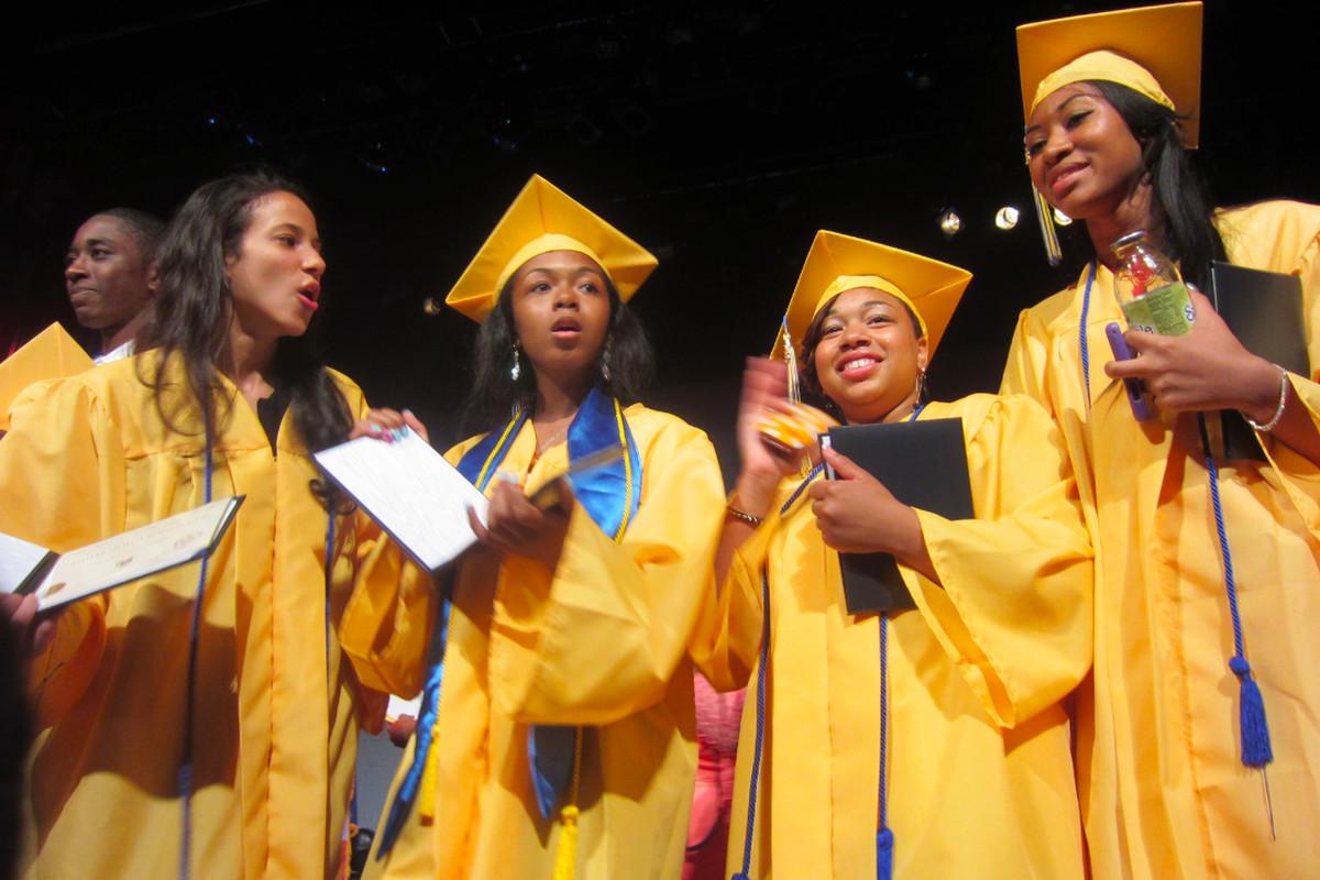 Democracy Prep graduates holding diplomas and Snapple.