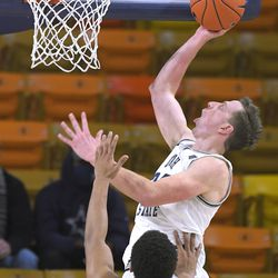 Utah State forward Justin Bean shoots as San Diego State forward Matt Mitchell (11) defends during the second half of an NCAA college basketball game Thursday, Jan. 14, 2021, in Logan, Utah.