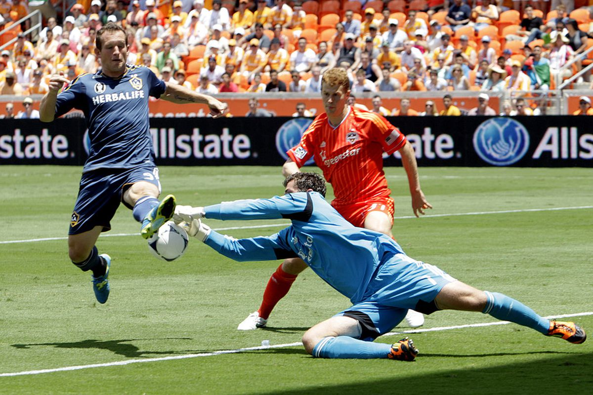 HOUSTON, TX - MAY 26:  Tally Hall #1 of the Houston Dynamo makes a save on a shot by Chad Barrett #9 of the Los Angeles Galaxy in the first half at BBVA Compass Stadium on May 26, 2012 in Houston, Texas.  (Photo by Bob Levey/Getty Images)