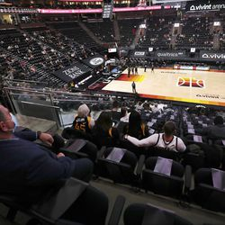 Utah Jazz fans are socially distanced as they watch the Jazz and Minnesota Timberwolves play in Salt Lake City on Saturday, Dec. 26, 2020.