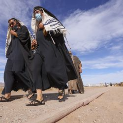 """Extras walk back to a costume tent between filming scenes of a faith-based streaming series on the life of Jesus Christ called """"The Chosen"""" at The Church of Jesus Christ of Latter-day Saints' Jerusalem set in Goshen, Utah County, on Monday, Oct. 19, 2020."""