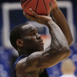 Brigham Young guard Charles Abouo shoots during practice, Monday, March 12, 2012, in Dayton, Ohio.