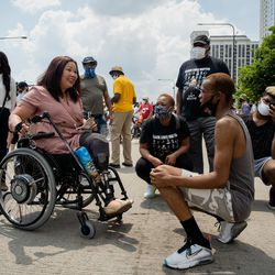 U.S. Sen. Tammy Duckworth chats with William Hooks, 24, from Englewood, before a march led by faith leaders and politicians to commemorate Juneteenth in downtown Chicago on June 19, 2020.