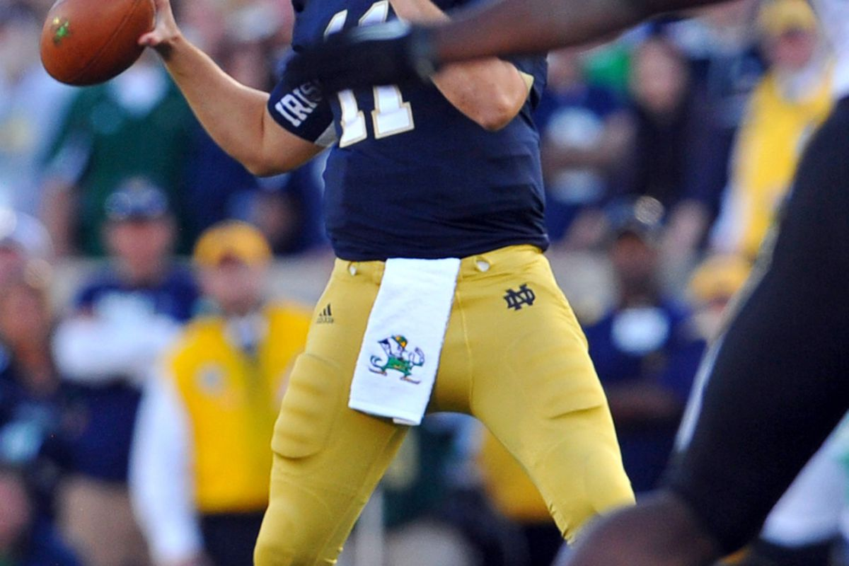 Sep 8, 2012; South Bend, IN, USA; Notre Dame Fighting Irish quarterback Tommy Rees (11) throws in the fourth quarter against the Purdue Boilermakers at Notre Dame Stadium. Notre Dame won 20-17. Mandatory Credit: Matt Cashore-US PRESSWIRE