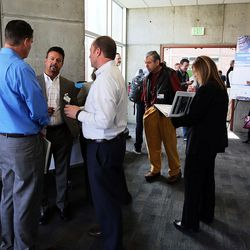 Attendees gather to talk during a break between courses at the MountainWest Capital Network Business Boot Camp in Sandy on Wednesday, March 23, 2016.
