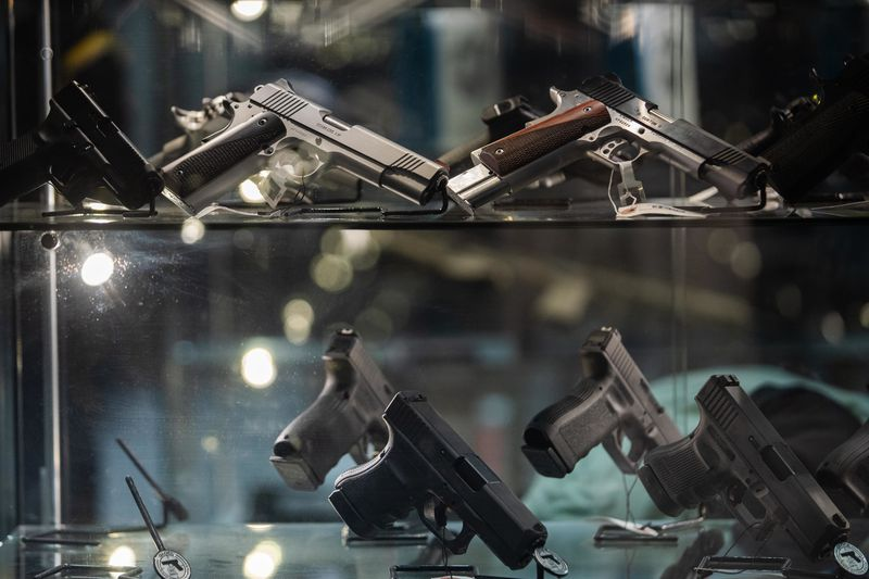 Guns on display at Kee Firearms and Training in New Lenox.
