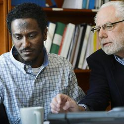 Yonas Fikre, left, a Portland, Oregon Muslim American talks to media with his attorney, Thomas Nelson, in Stockholm, Sweden, April 18, 2012. After a 2010 trip to visit family in Khartoum, Sudan,  Fikre claims to have been detained and tortured. Put on a FBI no-fly list,  Fikre is now unable to return home to the U.S.