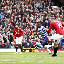 Manchester United's Wayne Rooney, second right, scores a penalty against Queens Park Rangers during their English Premier League soccer match at Old Trafford Stadium, Manchester, England, Sunday, April 8, 2012.