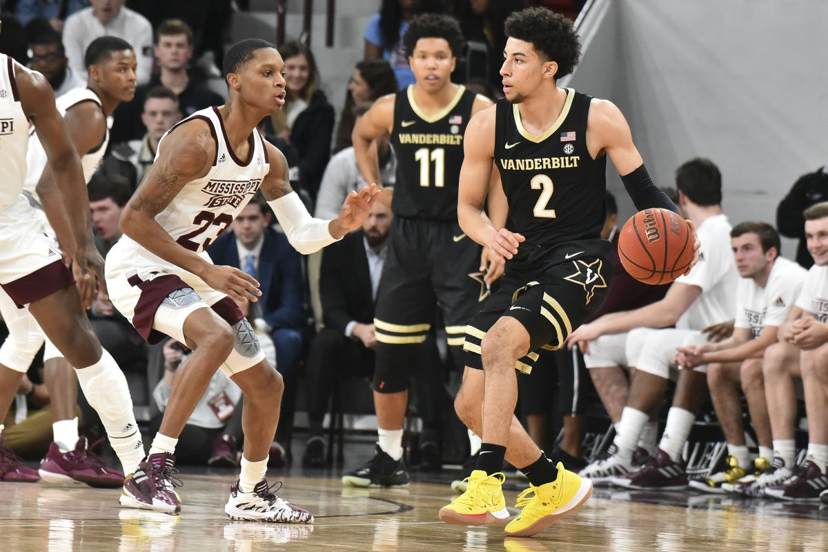 Vanderbilt Commodores guard Scotty Pippen Jr. handles the ball defended by Mississippi State Bulldogs guard Tyson Carter during the first half at Humphrey Coliseum.
