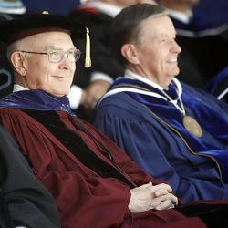 Elder Dallin H. Oaks, left, sits with BYU President Cecil O. Samuelson as the students pass by on their way into the Marriott Center for Spring Commencement Exercises at BYU Thursday, April 19, 2012.