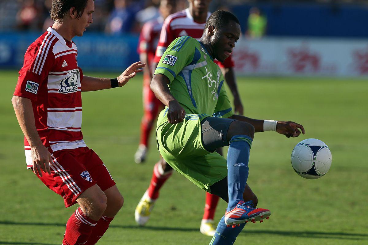 FRISCO, TX - SEPTEMBER 02:  Steve Zakuani #11 of Seattle Sounders FC dribbles the ball in front of Zach Loyd #17 of FC Dallas at FC Dallas Stadium on September 2, 2012 in Frisco, Texas.  (Photo by Ronald Martinez/Getty Images)