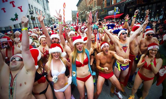 A group of people in swimsuits and Santa hats in a street in Atlanta.