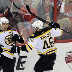 Boston Bruins defenseman Andrew Ference (21) celebrates his goal with David Krejci (46), of the Czech Republic, during the third period of Game 6 of an NHL hockey Stanley Cup first-round playoff series against the Washington Capitals, Sunday, April 22, 2012, in Washington.