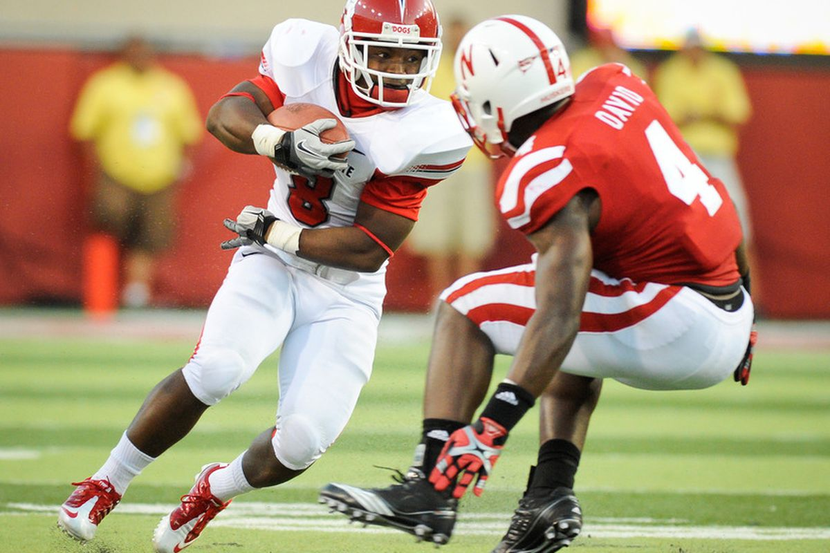 LINCOLN, NE - SEPTEMBER 10: Robbie Rouse #8 of the Fresno State Bulldogs tries to avoid Lavonte David #4 of the Nebraska Cornhuskers during their game at Memorial Stadium September 10, 2011 in Lincoln, Nebraska.  (Photo by Eric Francis/Getty Images)