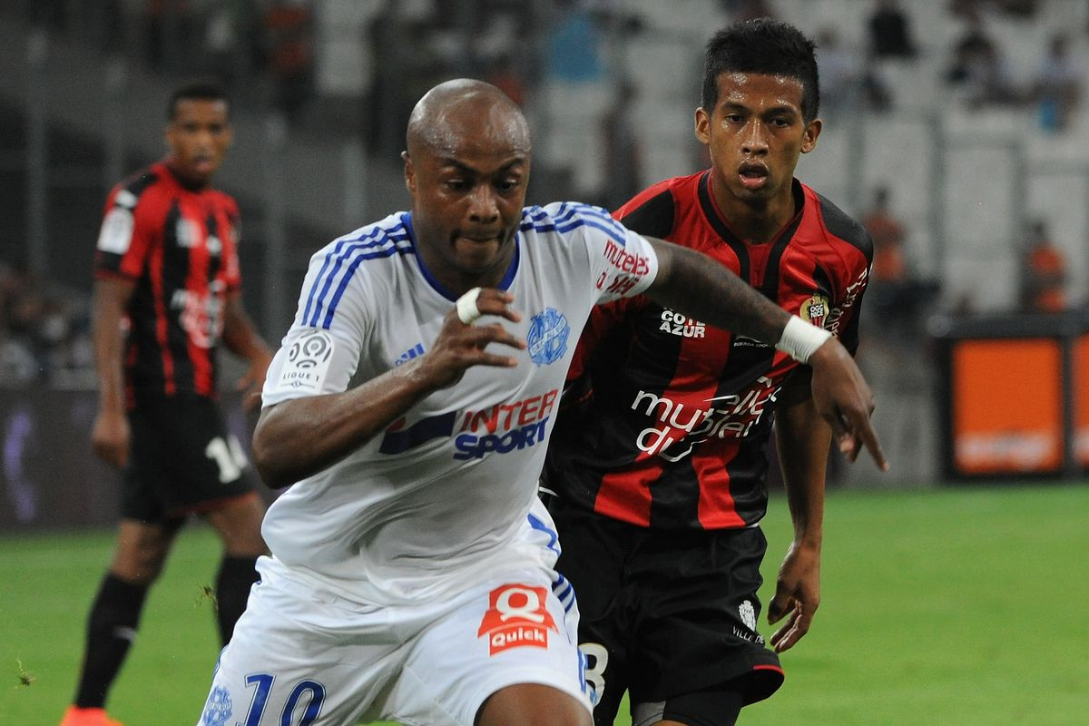 Swansea's André Ayew, then at Marseille, and Villa's Jordan Amavi, then at Nice, contest a ball during Ligue 1 play in August 2014.