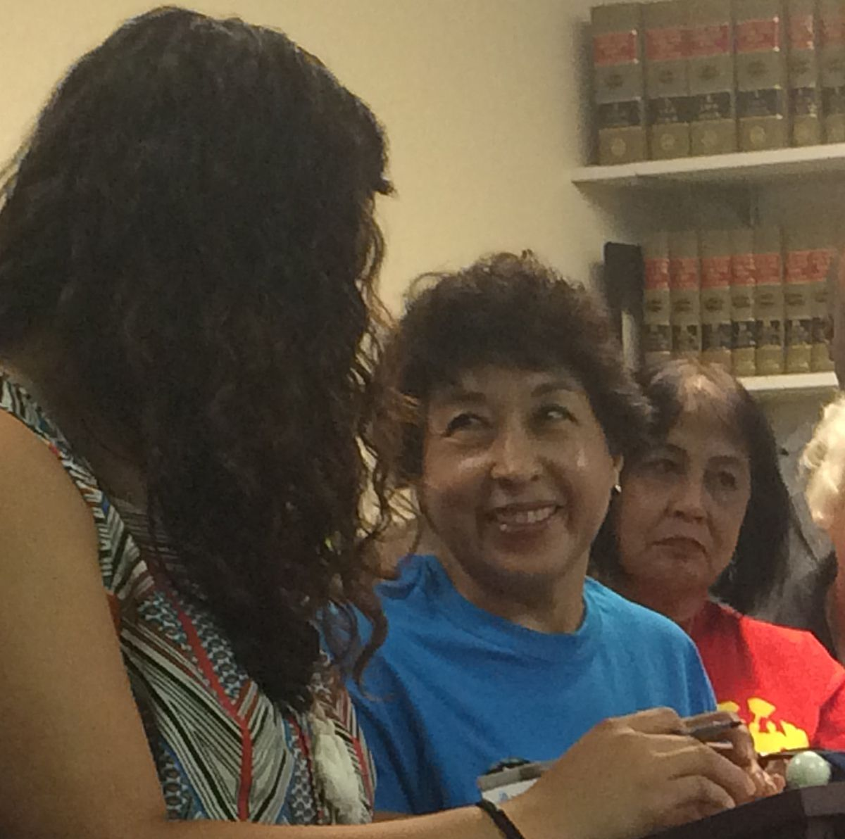 Maria Esther Bolaños looks at Gaby Benitez, organizer for the Illinois Domestic Workers Coalition, who helped translate Bolaños' remarks at Tuesday's news conference. | Angie Stewart/Sun-Times