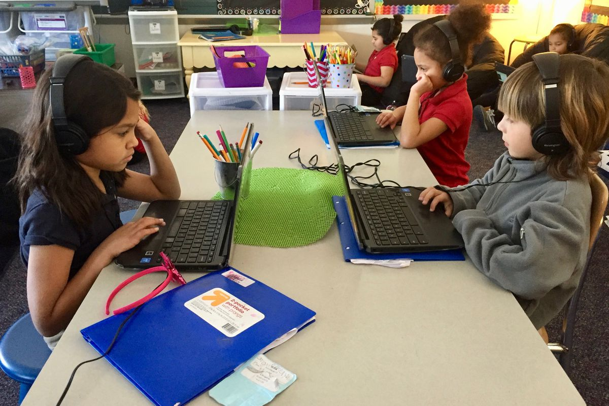 First-grade students work on English and math skills.