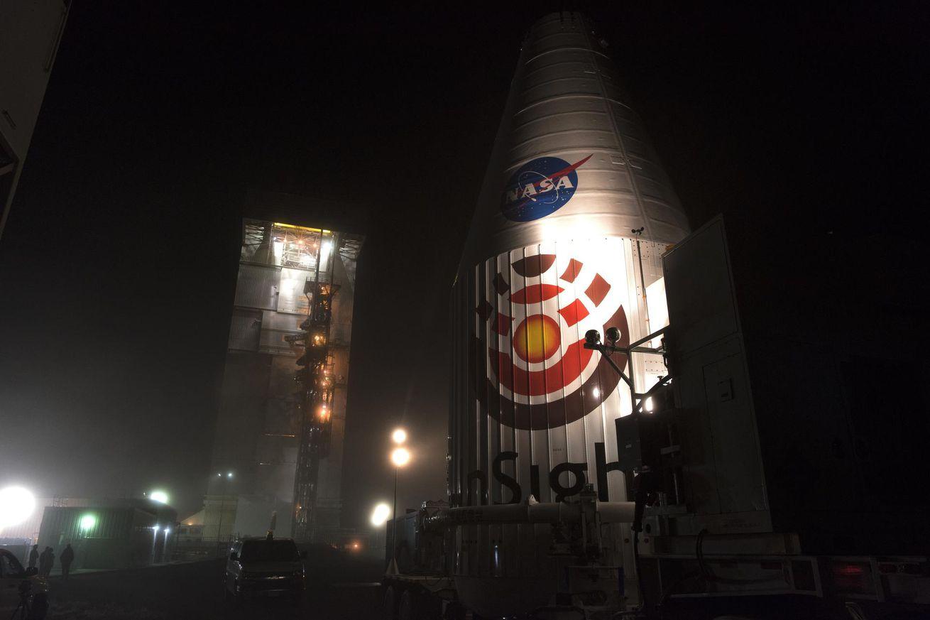 <em>NASA's InSight lander inside its rocket's nose cone, awaiting launch</em>