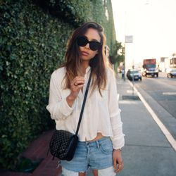 """Rumi of <a href=""""http://www.fashiontoast.com""""target=""""_blank"""">Fashion Toast</a> is wearing an H&M blouse, Current/Elliott shorts, a Goyard bag, Céline sunglasses and Cartier and Line & Jo jewelry."""