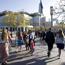 Thousands walk toward the Conference Center for the Saturday morning session of General conference Saturday, Oct. 6, 2012.
