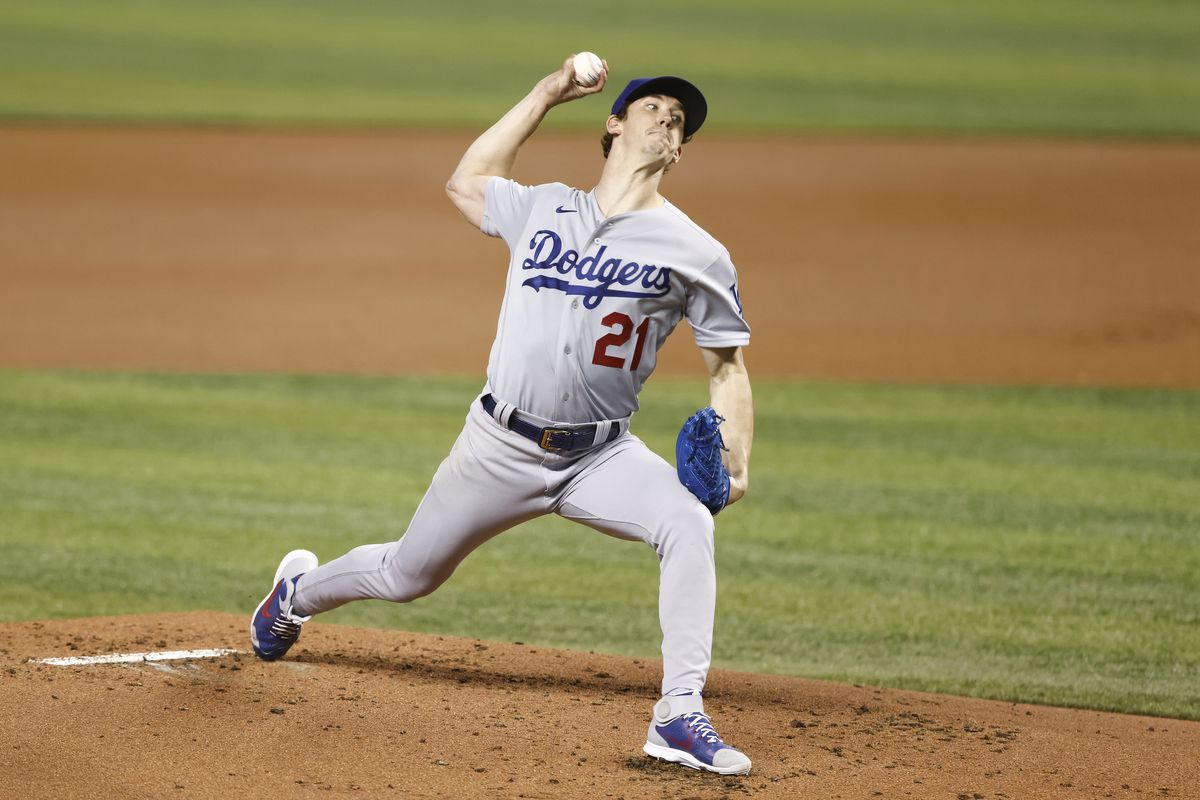 Walker Buehler #21 of the Los Angeles Dodgers delivers a pitch against the Miami Marlins during the first inning at loanDepot park on July 05, 2021 in Miami, Florida.