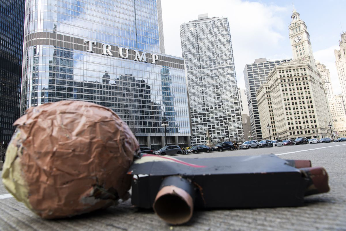 """An broken effigy of President Donald Trump lays on Wacker Drive at a """"stop the steal"""" protest on Thursday, Nov. 26, 2020."""