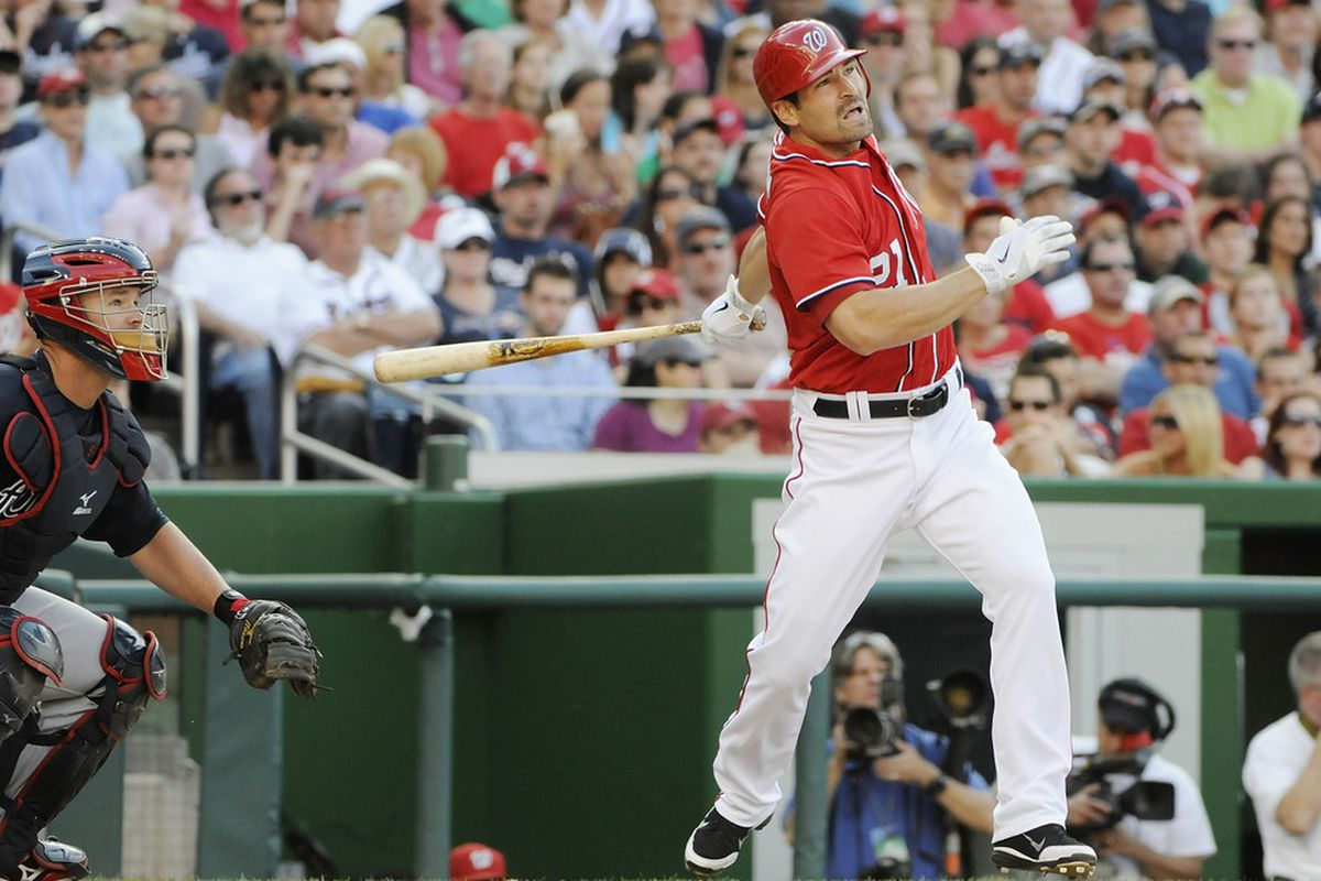 WASHINGTON, DC - JUNE 02:  Xavier Nady of the Washington Nationals hits an RBI double against the Atlanta Braves during the seventh inning of their game at Nationals Park on June 2, 2012 in Washington, DC.  (Photo by Jonathan Ernst/Getty Images)