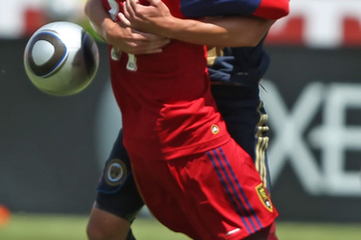 SANDY, UT - MAY 8: Javoer Morales #11 of Real Salt Lake and Kyle Nakazawa #13 of Philadelphia Union get tied up during the first half of an MLS soccer game in Rio Tinto Stadium May 8, 2010 in Sandy, Utah. Photo by George Frey/Getty Images)
