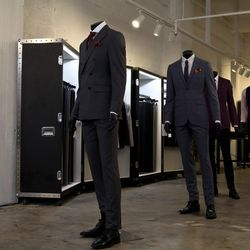 Although they tend to be a bit more formal and are usually associated with tuxedos, a one-button suit is the most fashion-forward at the moment. A two-button suit is the standard. Unless you're six feet tall, try to avoid getting a three-button suit as th