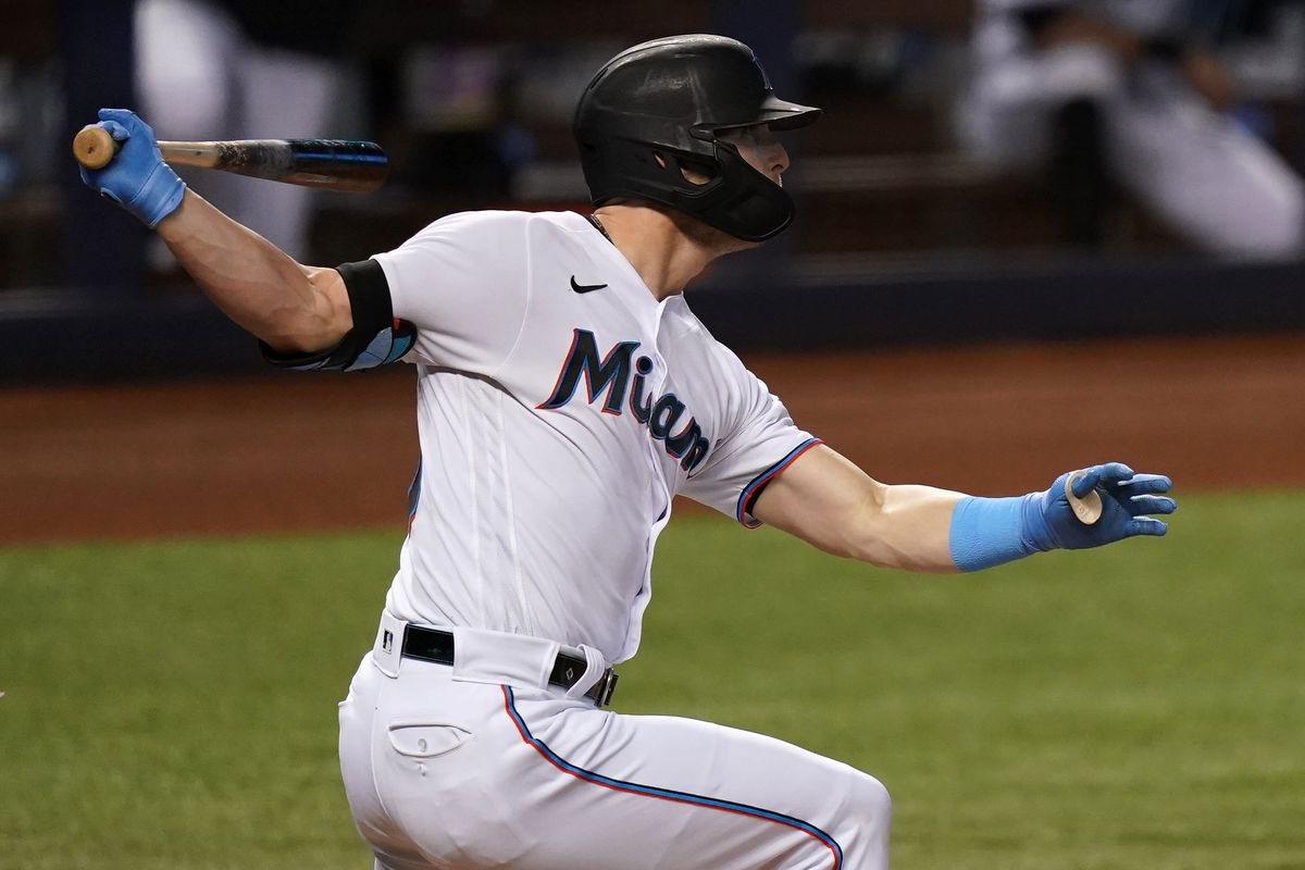 Miami Marlins left fielder Corey Dickerson (23) doubles in the 1st inning against the Colorado Rockies at loanDepot park