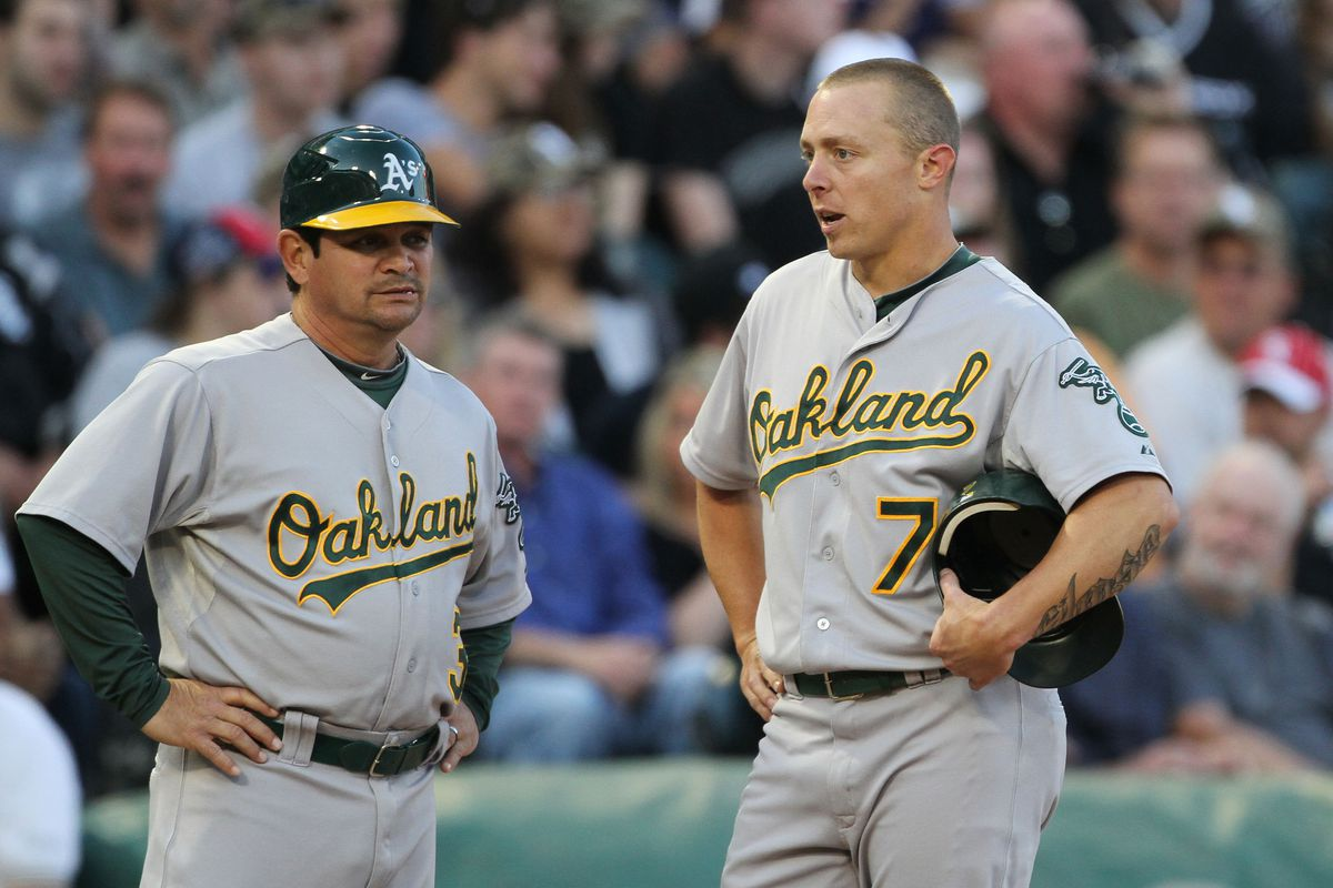 CHICAGO, IL - AUGUST 11: Mike Gallego #3 and Brandon Inge #7 of the Oakland Athletics chat on the field against the Chicago White Sox at U.S. Cellular Field on August 11, 2012 in Chicago, Illinois.  (Photo by Tasos Katopodis /Getty Images)