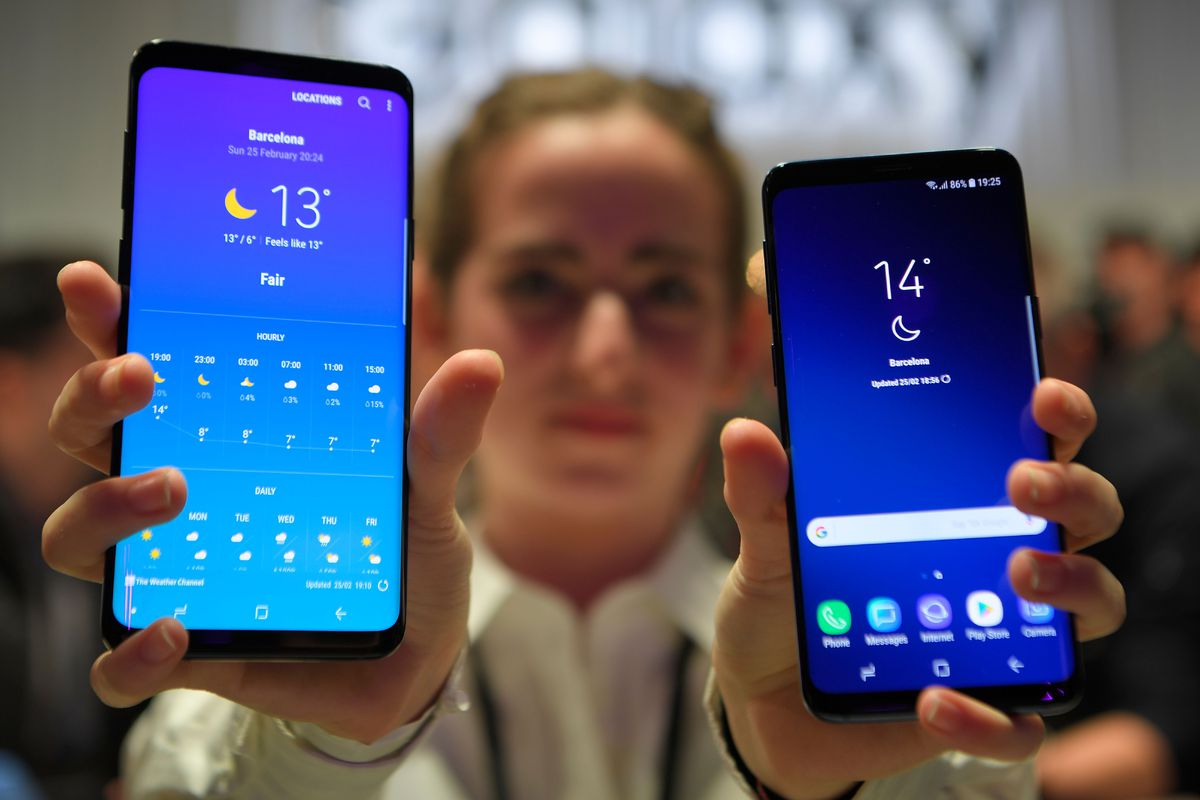 Demonstrating the new Samsung Galaxy S9 smartphone at the Mobile World Congress on Feb. 25, 2018, in Barcelona, Spain.