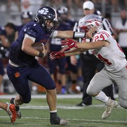 Brighton's Gabe Curtis (1) runs with the ball past Bountiful's Drew Bowles (24) during a football game at Brighton High School in Cottonwood Heights on Friday, Sept. 4, 2020.