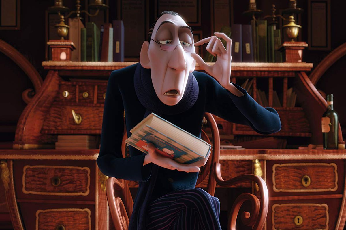 """A still from the Pixar movie """"Ratatouille"""" showing a man holding a book while peering over his glasses condescendingly."""