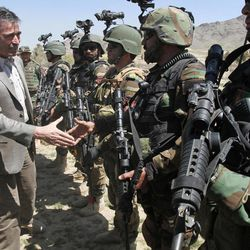 NATO Secretary-General Anders Fogh Rasmussen, left, shakes hand with members of Afghan special forces during his visit to the commando training center in Kabul, Afghanistan, Thursday, April 12, 2012. Rasmussen, said Afghan troops would be ready to take the lead role around the country by mid-2013, allowing international combat forces to move into a support and training role.