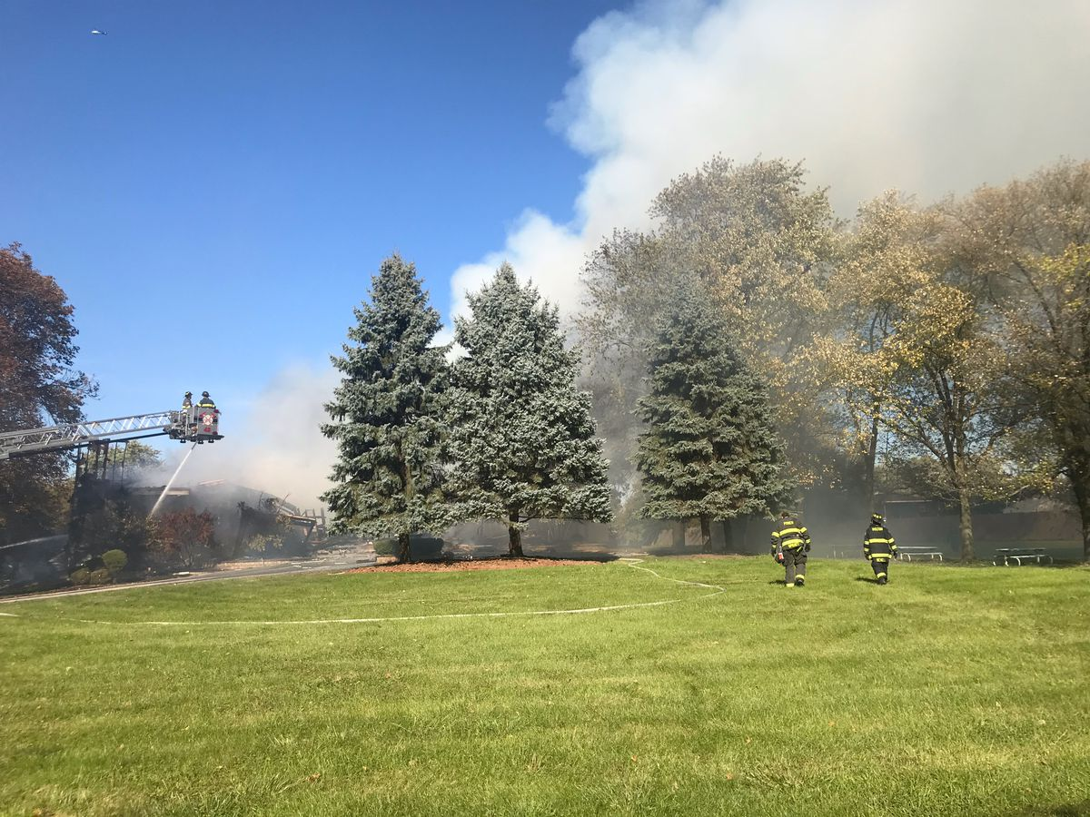 Firefighters battle a large fire at the former home of NBA player Dwyane Wade in south suburban Dolton. | Justin Jackson/Sun-Times