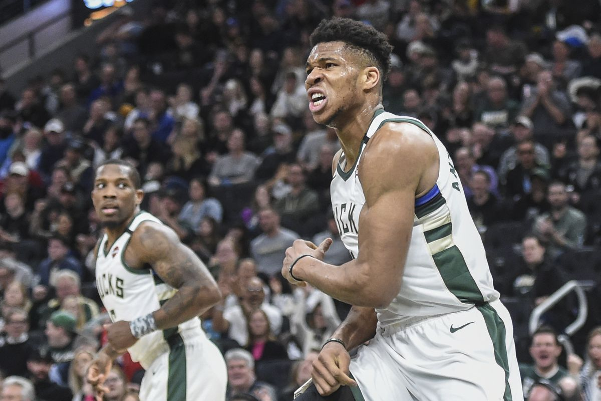 Milwaukee Bucks forward Giannis Antetokounmpo reacts after scoring a basket in the third quarter during the game against the Phoenix Suns at Fiserv Forum.