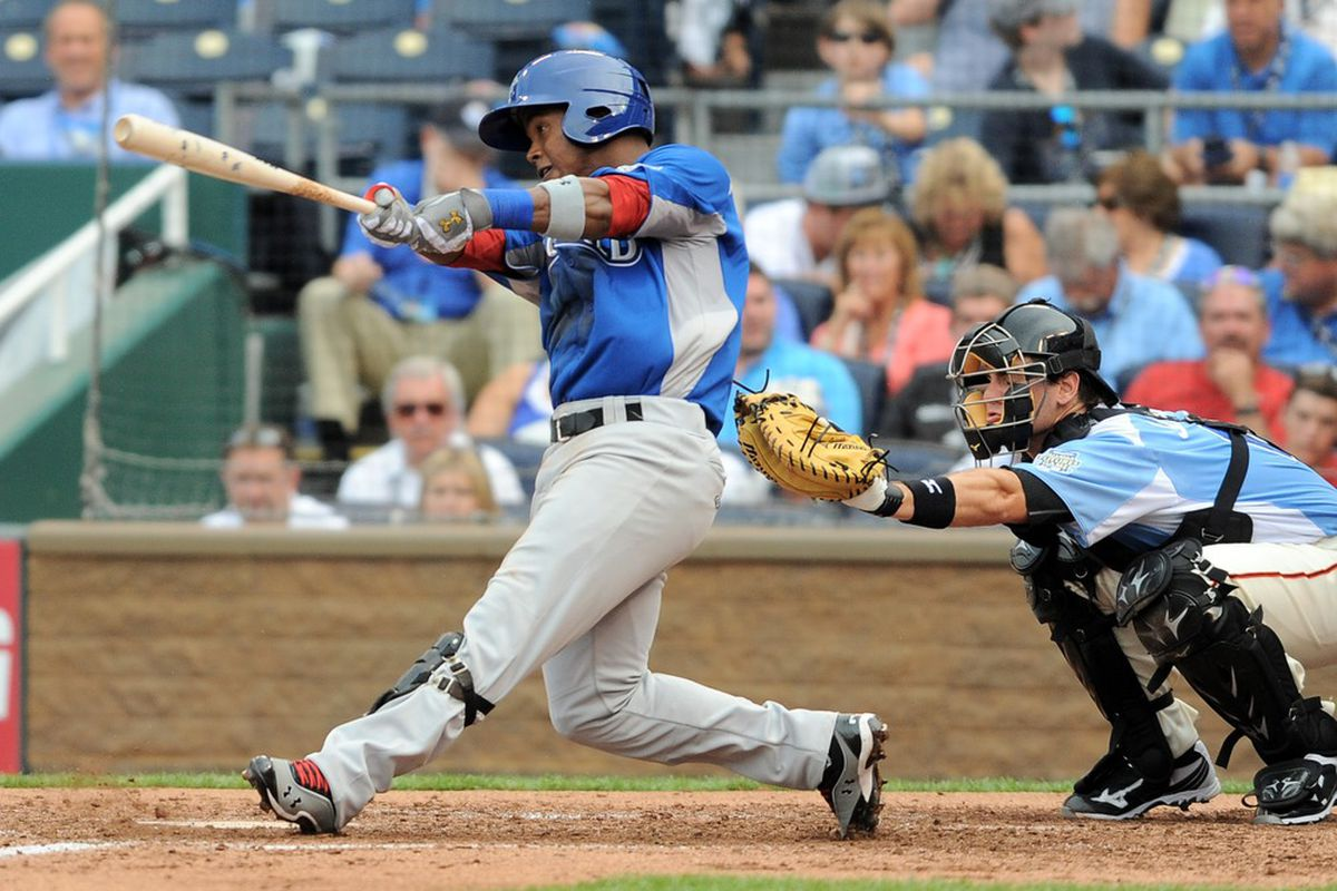 July 8, 2012; Kansas City, MO, USA; World infielder Jean Segura hits a single during the fourth inning of the 2012 All Star Futures Game at Kauffman Stadium.  Mandatory Credit: Denny Medley-US PRESSWIRE
