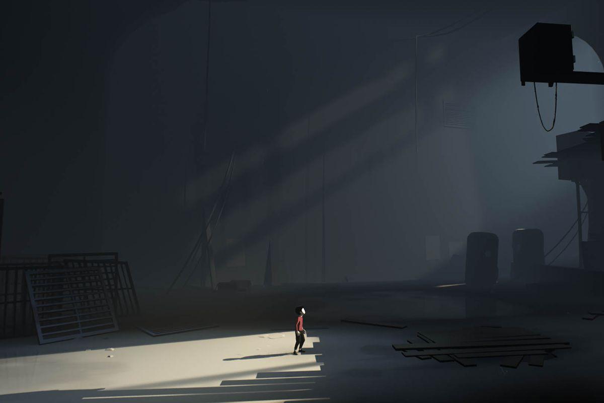 Inside - boy standing in shaft of light