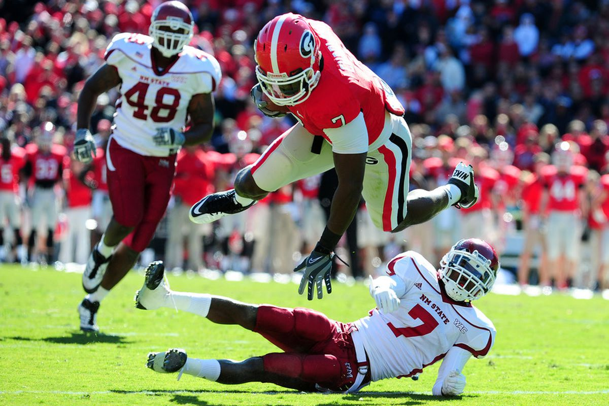 ATHENS, GA - NOVEMBER 5: Orson Charles #7 of the Georgia Bulldogs runs with a catch against Courtney Viney #7 of the New Mexico State Aggies at Sanford Stadium on November 5, 2011 in Athens, Georgia.  (Photo by Scott Cunningham/Getty Images)