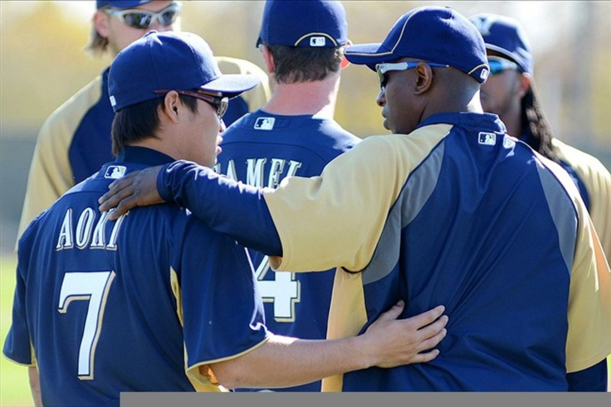 Feb 26, 2012; Phoenix, AZ, USA; Milwaukee Brewers center fielder Nyjer Morgan (right) puts an arm around left fielder Norichika Aoki (7) during a workout during spring training at Maryvale Baseball Park.  Mandatory Credit: Jake Roth-US PRESSWIRE