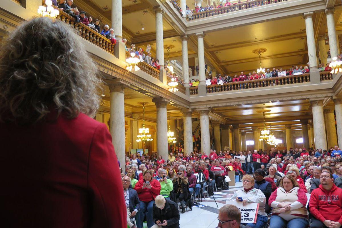 State Superintendent Glenda Ritz waits her turn to speak at a Statehouse rally.