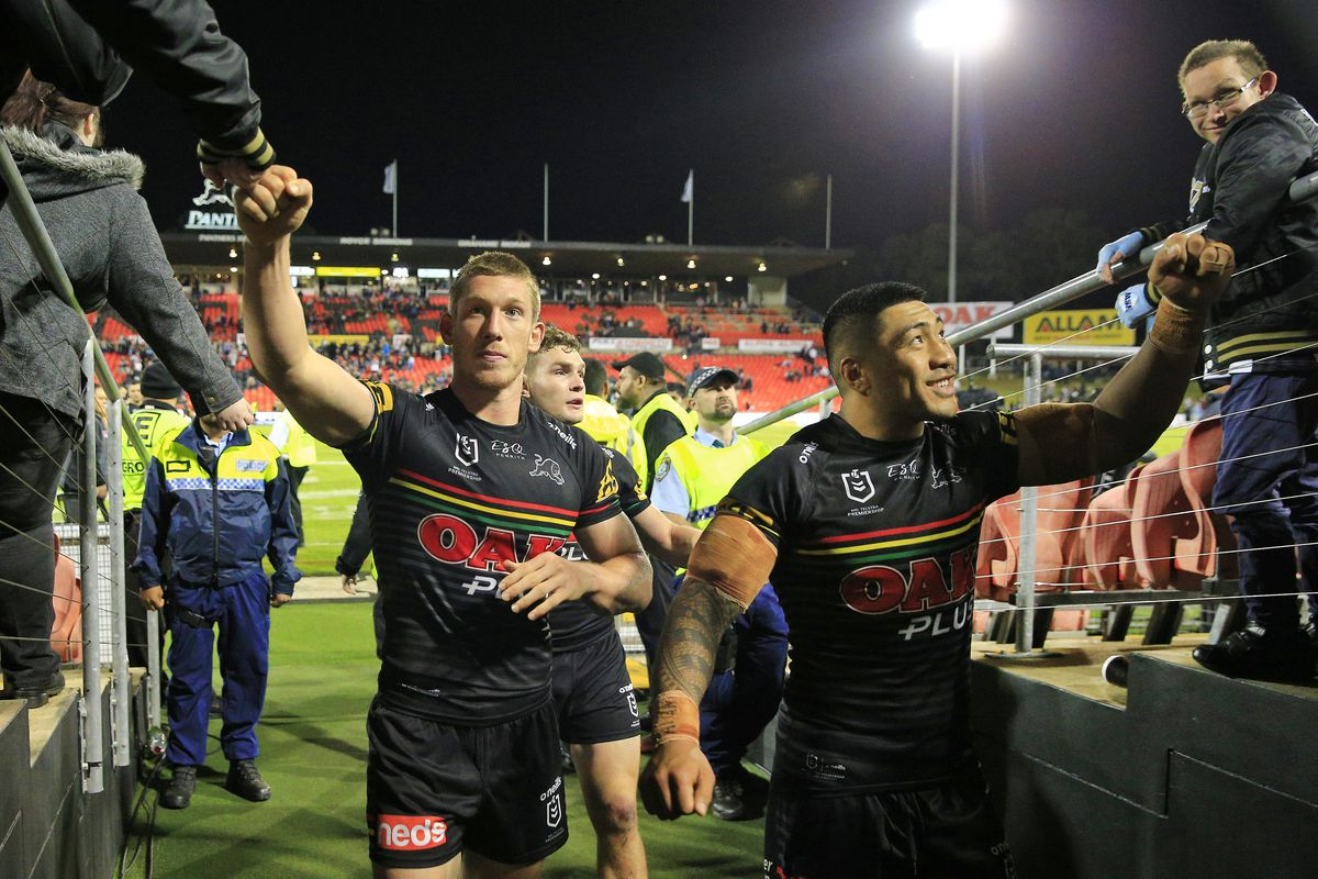 Panthers players fist pump fans after the round 1 NRL match between the Penrith Panthers and the Sydney Roosters at Panthers Stadium on March 14, 2020 in Penrith, Australia.